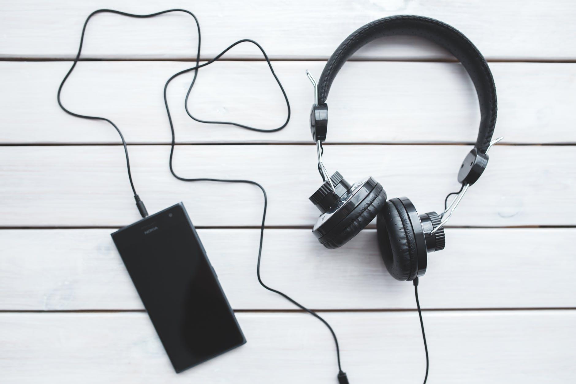 black headphones with mobile smartphone